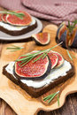 Bread with goat cheese fresh figs honey and rosemary vertical Royalty Free Stock Photo
