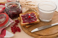 Bread with jam for breakfast and milk toasted Royalty Free Stock Photography