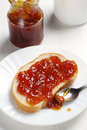 Bread with jam and glass jar on white background Stock Photo