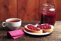 Bread with jam and tea raspberry glass jar cup of Stock Images
