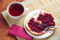 Bread with jam and tea raspberry on plate cup of Royalty Free Stock Photos