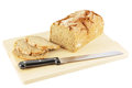 Bread with knife Royalty Free Stock Photo