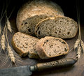 Bread knife and with wheat Royalty Free Stock Photography