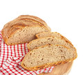Bread loaf cut artisan on checkered napkin Stock Photography