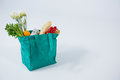 Bread loaf and vegetables in grocery bag Royalty Free Stock Photo