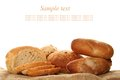 Bread a lot of different breads are on sackcloth isolate Royalty Free Stock Photography