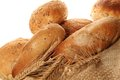 Bread a lot of different breads are on sackcloth isolate Royalty Free Stock Photo