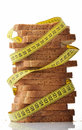 Bread with measure tape indicating weight loss Stock Images