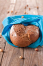 Bread with nuts on the wooden table selective focus Royalty Free Stock Photos