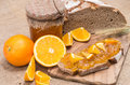 Bread with Orange Jam (rustic background) Stock Photo