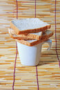 Bread over the cup on bamboo plate Stock Photos