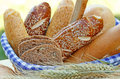 Bread and pastry in wicker basket Stock Photos