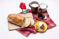 Bread with plum jam cup of milk on white studio shot Royalty Free Stock Images