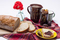 Bread with plum jam cup of milk on white studio shot Royalty Free Stock Photography