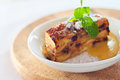 Bread pudding baked with raisins baked in creamy egg custard served with warm vanilla sauce and sugar Royalty Free Stock Photo