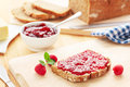 Bread with raspberry jam breakfast table and Stock Image