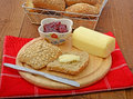 Bread roll with butter and jam wholemeal on cutting board Stock Photos