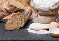 Bread roll or french baguette and flour on black chalkboard Stock Images
