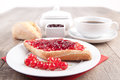 Bread roll with jam picture of a Royalty Free Stock Photo