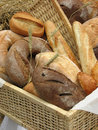 Bread and rolls in a basket, still life Royalty Free Stock Photo