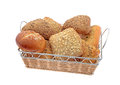 Bread rolls in basket whole grain and white isolated on white background Royalty Free Stock Photography