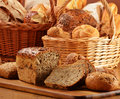 Bread and rolls in wicker basket Stock Image