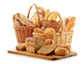 Bread and rolls in wicker basket isolated on white Stock Photography