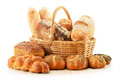 Bread and rolls in wicker basket isolated on white Royalty Free Stock Photos