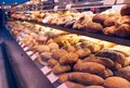 Bread showcase on in supermarket close up view Stock Photos