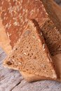 Bread sliced with sunflower seeds nuts and raisins closeup triangle on a wooden board Stock Photo