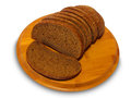 Bread slices on the wooden board Stock Photography