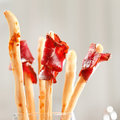Bread-stick with parma ham Royalty Free Stock Photography