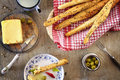 Bread sticks with butter. Royalty Free Stock Photo