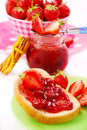 Bread with strawberry confiture Royalty Free Stock Photo