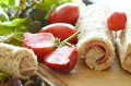 Bread stuffed pork bologna roll with cut strawberry and vegetable on chop block Royalty Free Stock Photo