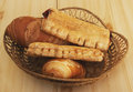 Bread and sweet pies in basket pastries braided on table Stock Photography
