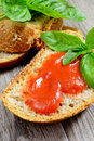 Bread and tomato sauce wheat with fresh basil mediterranean Royalty Free Stock Photo
