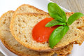 Bread and tomato sauce wheat with fresh basil mediterranean Royalty Free Stock Photography
