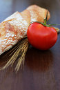 Bread and tomato on a table Royalty Free Stock Photography