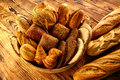 Bread varied mix on golden aged wood table Royalty Free Stock Photo