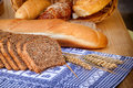 Bread and various baked goods pastry in wicker basket on the table Stock Photos