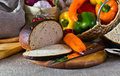 Bread vegetables and fresh on a linen fabric Royalty Free Stock Image