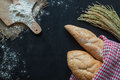 Bread , wheat and flour on black chalkboard , bakery background Royalty Free Stock Photo
