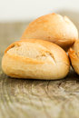 Bread on wooden table close up round loafs Stock Photos