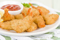 Breaded butterfly prawns deep fried battered filled with garlic sauce served with chili sauce and lemon wedges Royalty Free Stock Photos