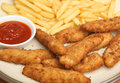 Breaded chicken nuggets with fries goujons or niggets and tomato ketchup Stock Images