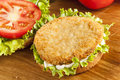 Breaded chicken patty sandwich on a bun with lettuce and tomato Stock Image