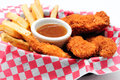 Breaded chicken strips with french fries and dipping sauce in a diner basket Stock Photo