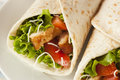 Breaded chicken in a tortilla wrap with lettuce and tomato Royalty Free Stock Photography