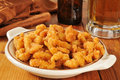 Breaded clams a bowl of deep fried with a mug of beer Royalty Free Stock Photos